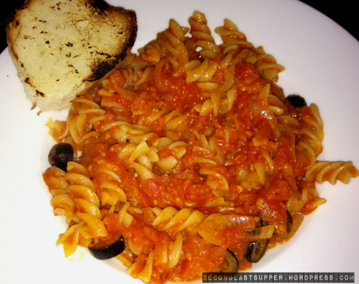 Puttanesca pasta (pasta in fresh tomato sauce with spring onion, chillies, garlic and herbs)