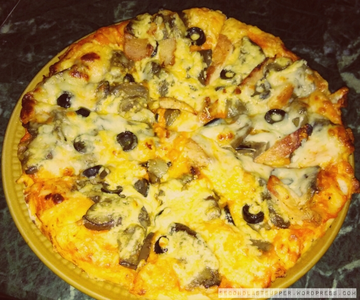 Quattro frommagi(ie 4 cheese) pizza with black olives, chicken and aubergines
