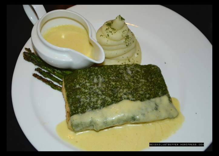 Herb crusted gratinated salmon stake