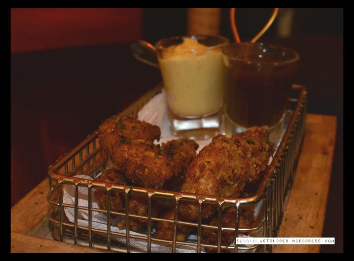 crispy chicken strips with BBQ sauce
