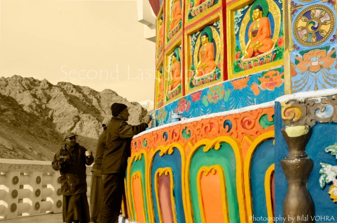 Rare sight where locals are trying to fix a painting on Shanti Stupa.