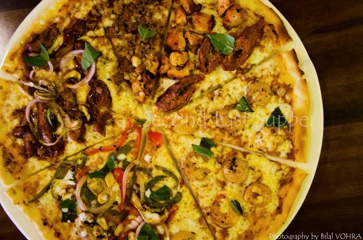 Pizza Sampler with Vegetarian Nirvana, BBQ chicken, Tandoori all-star & chilli prawn pizza