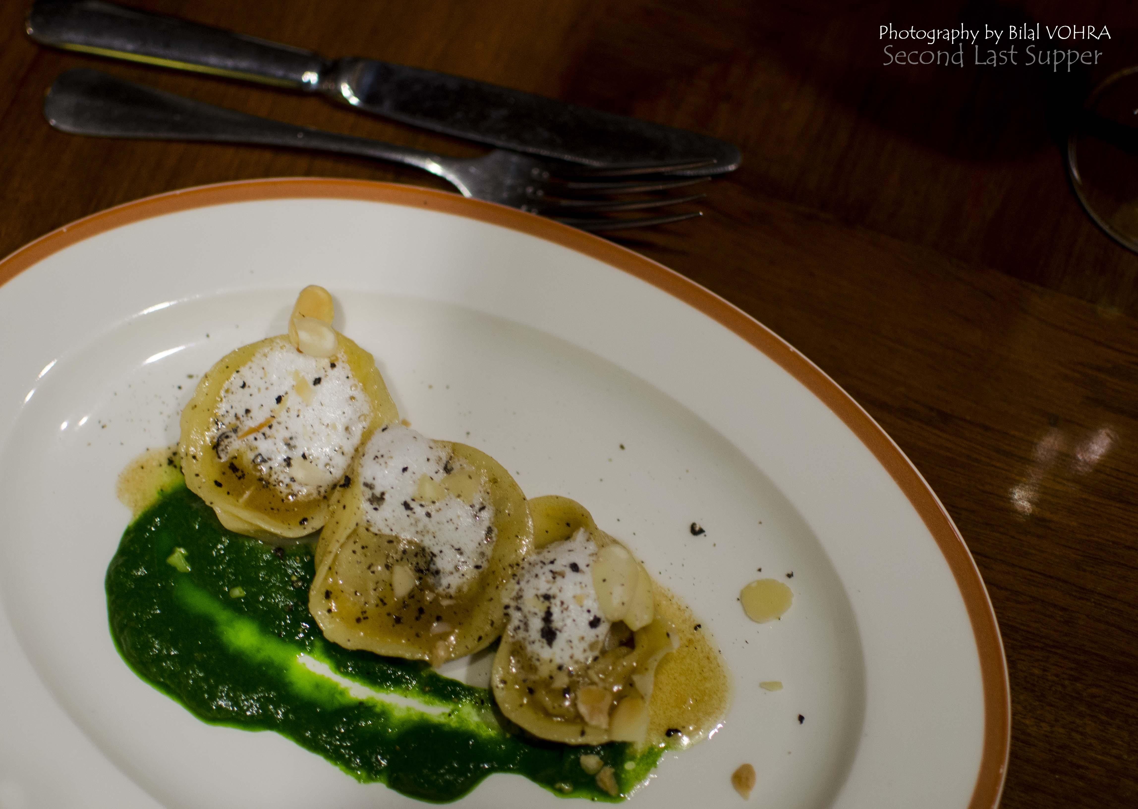 Tortellini ripieni di funghi, burro bruciato, mandorle, schiuma di latte (Mushroom stuffed tortellini, brown butter sauce)