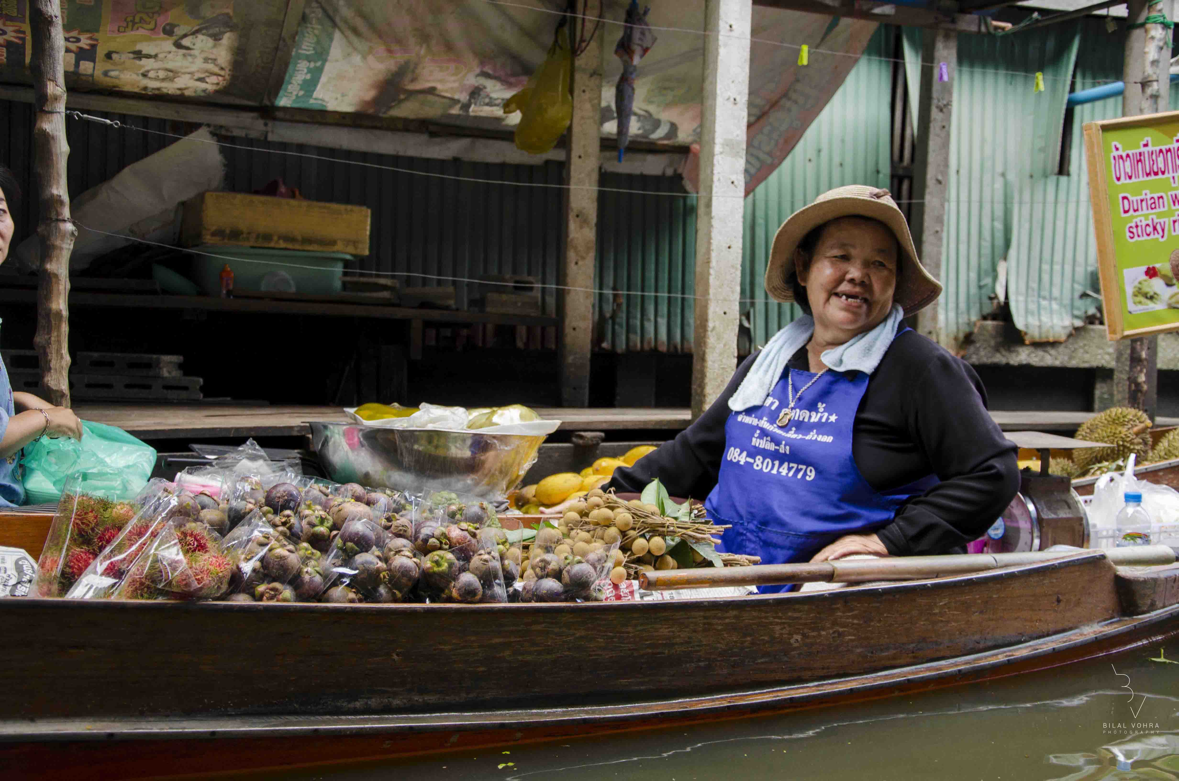 The ever so happy lady selling Mangosteen & Longan